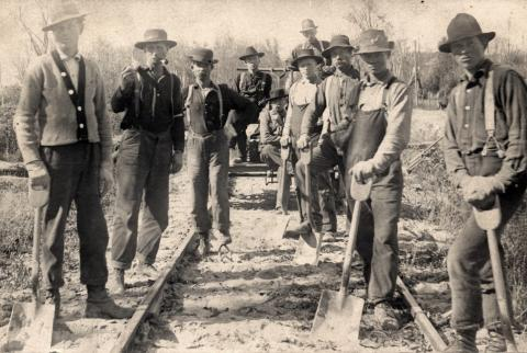 Railroad crew laying track, Thief River Falls, Minnesota
