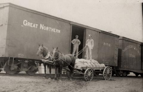 Men unloading railcar in Frost, Minnesota